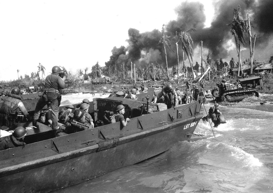 Australian troops storm ashore in the first assault wave to hit Balikpapan on the southeast coast of oil-rich Borneo - NARA - 513227